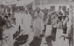 Swami Chinmayananda being welcomed at his alma mater, Vivekodayam Boys High School, Thrissur.